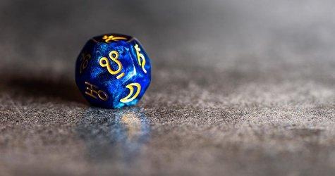 Blue Astrology Dice with symbol of Ketu on dark grey background