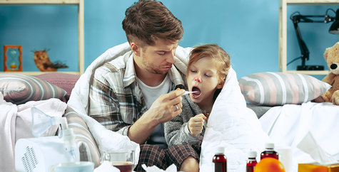 Sick man with daughter at home. Home Treatment. Fighting with a desease. Medical healthcare. Family iIlness. The winter, influenza, health, pain, parenthood, relationship concept. Relaxation at Home